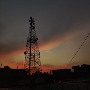 A sunset behind a cell tower